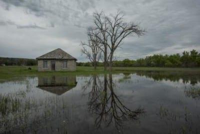 Water flooding from the North Platte River surrounds a shed near Lewellen, Neb. (Photo: Peter Stegen | Platte Basin Timelapse)
