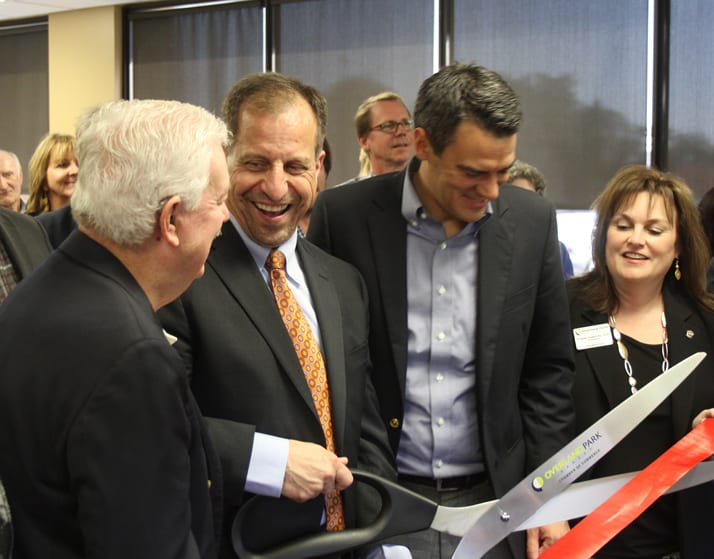 Valley Hope President and CEO Pat George shares a laugh with Kansas House Speaker Ray Merrick, left, and U.S. Rep. Kevin Yoder, right, before cutting the ribbon on a new outpatient abuse treatment facility in Overland Park. (Photo: Andy Marso | Heartland Health Monitor)