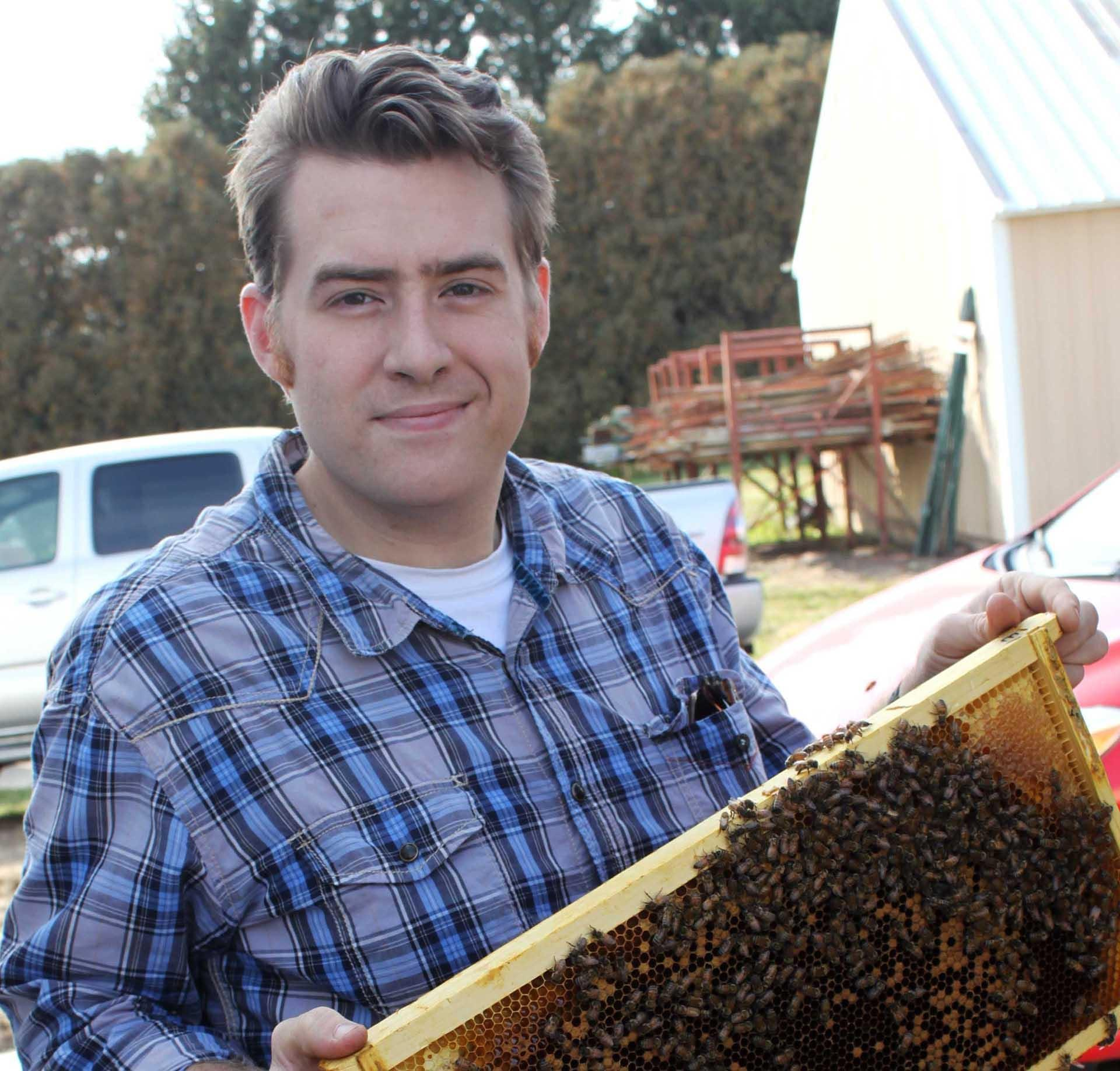 Iowa State University's Adam Dolezal says new research shows that people have contributed to honeybee disease spread. (Photo: Courtesy Adam Dolezal)