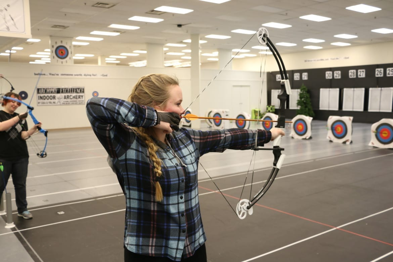 Three-time Missouri State Champion Shelby Winslow practicing archery