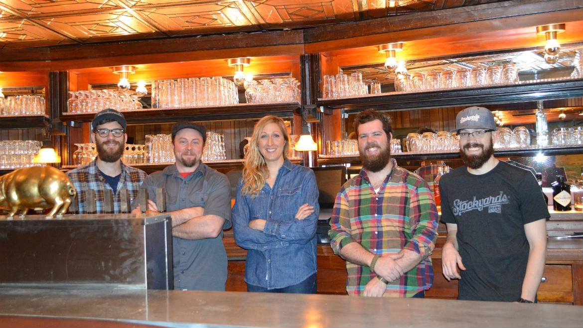 Brendan Gargano, Micah Weichart, Melissa VanGoethem, Greg Bland, and Ray Kerzner behind the bar at Stockyards Brewing Company. (Photo: Jonathan Bender | Flatland)