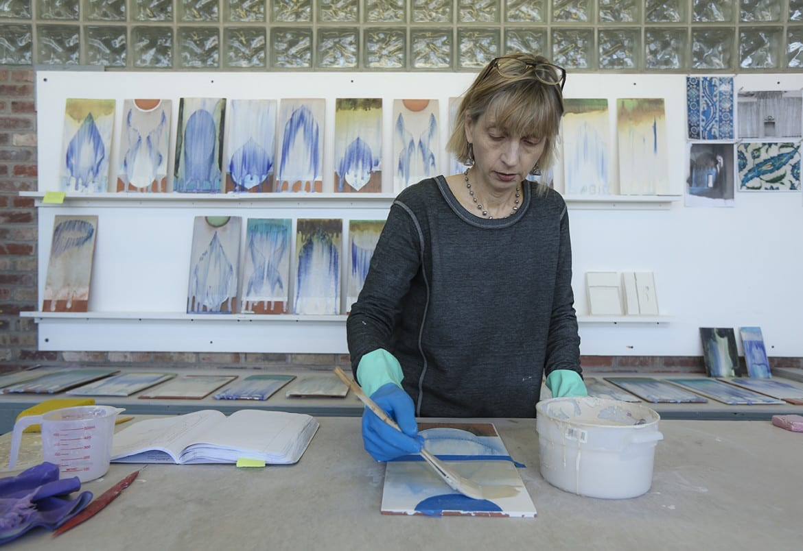 Cary Esser glazes ceramic tiles for a new series of work titled