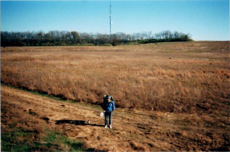 A man walking in a field