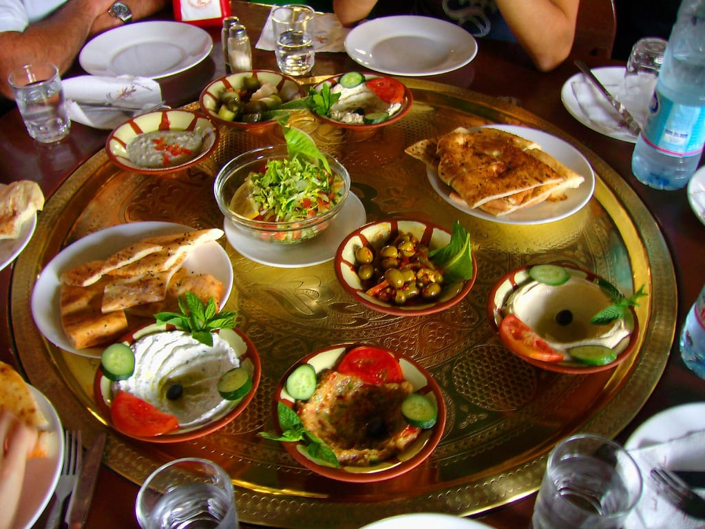 This photo shows food commonly served during Ramadan, including an entree of beef or chicken, a salad, and rice.
