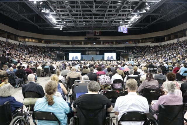 A crowd of people inside an arena