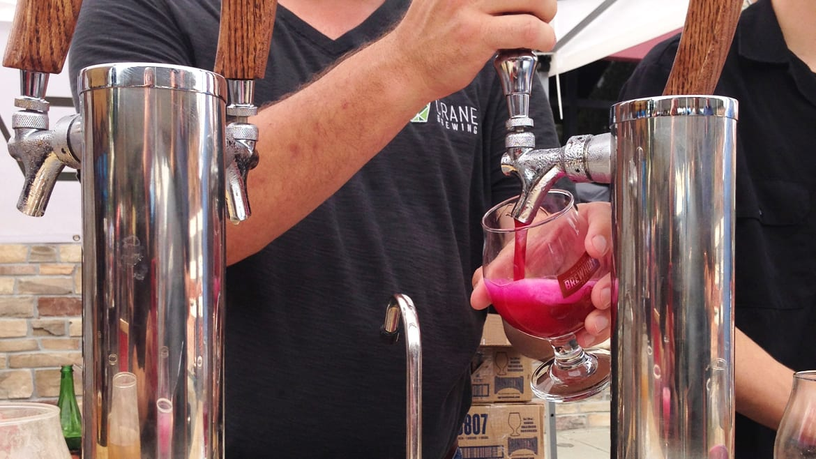 A pink beer being poured.