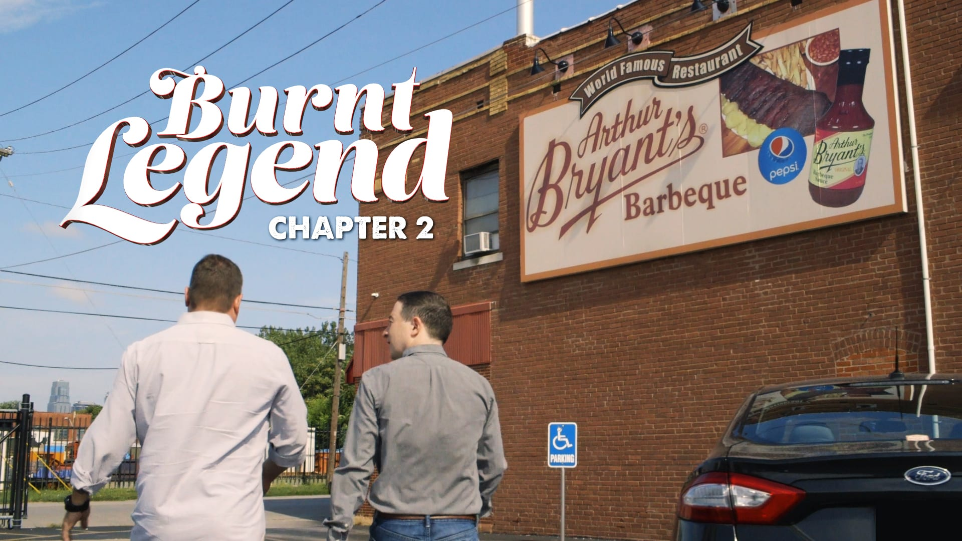 Two men walking int a BBQ joint