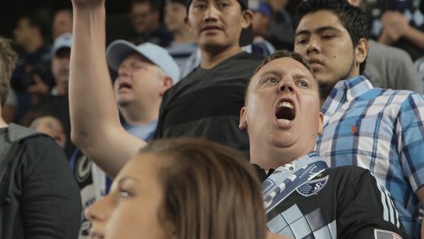 A soccer fan chanting