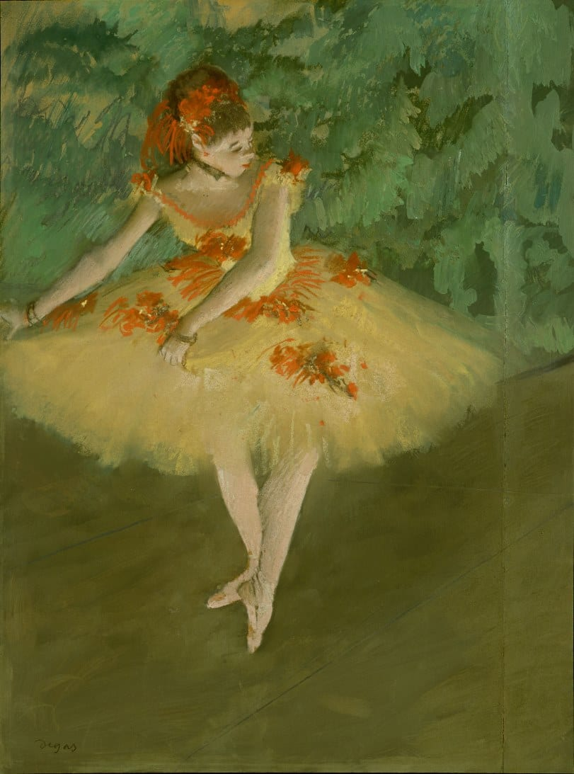 A painting by Degas of a ballerina.