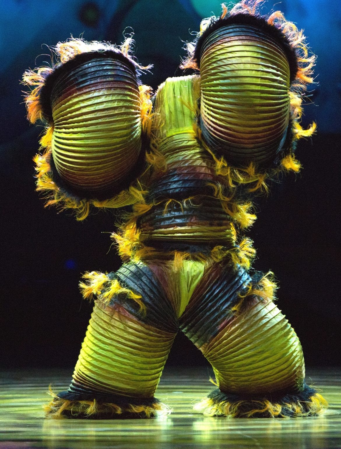 A Cirque du Soleil character on stage.