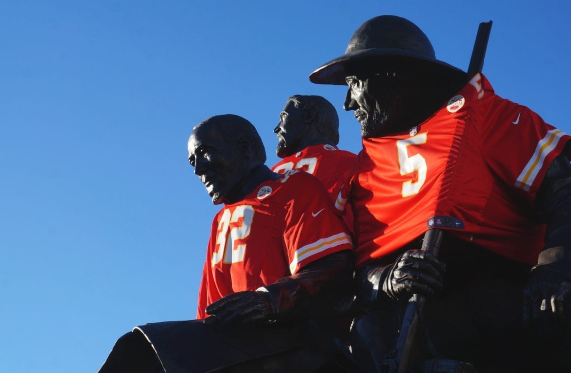 A statue dressed in Chiefs shirts.