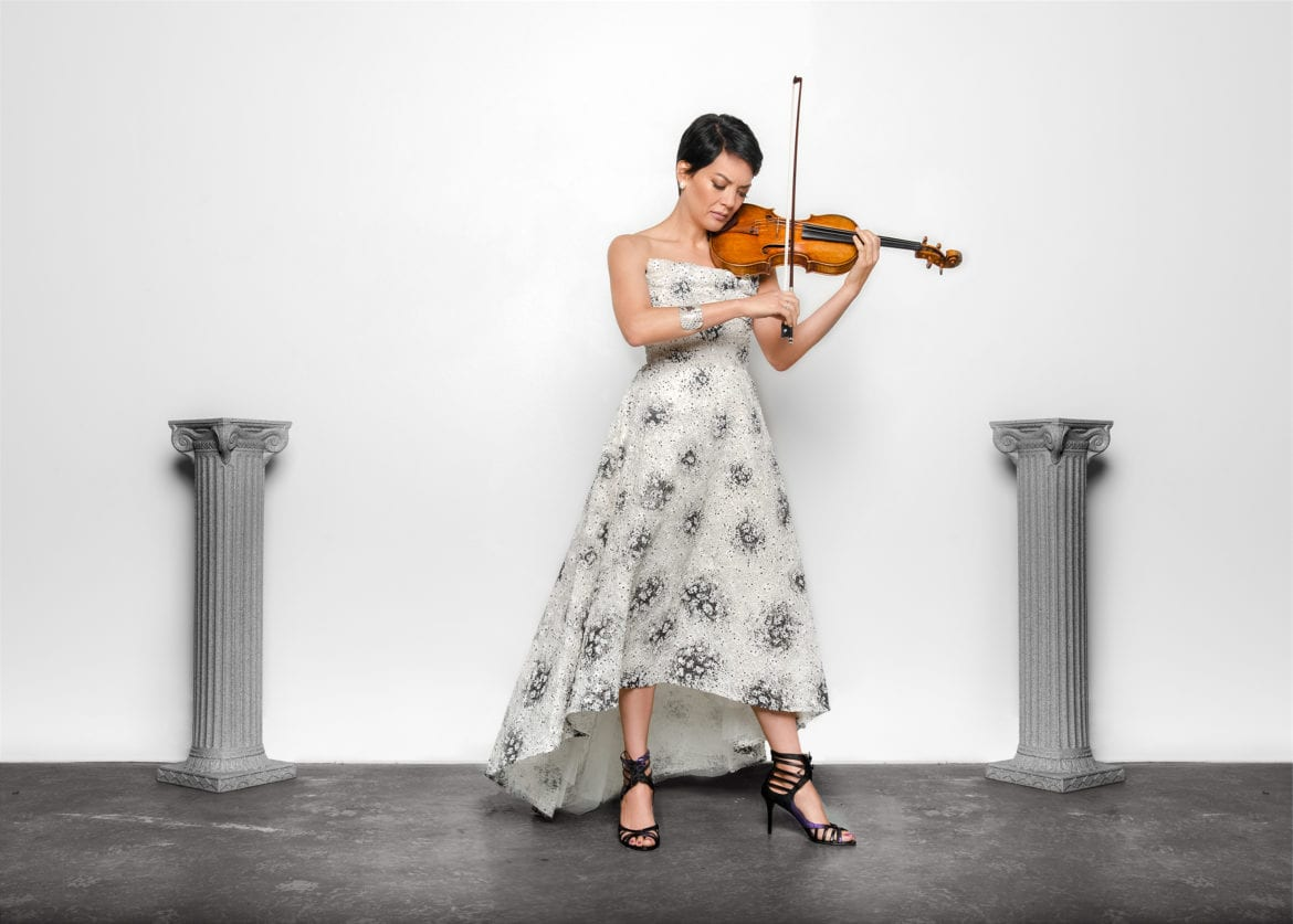 A woman playing the violin.