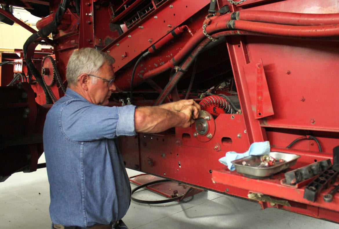 Guy Fixing Tractor : What farmers lobbying for the right to repair their