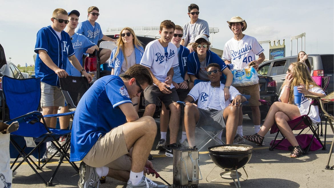 Tailgaters light a charcoal fire at Kauffman Stadium