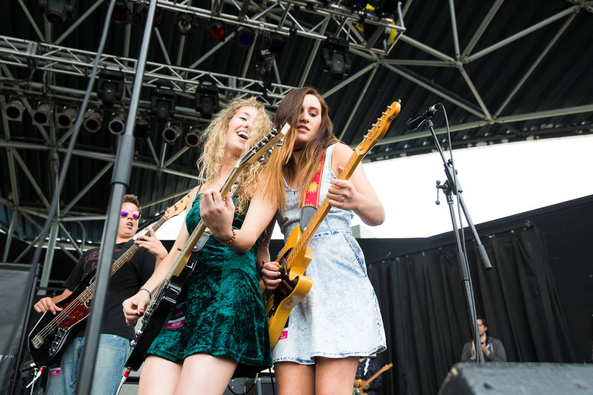 Two young women rock out on guitars