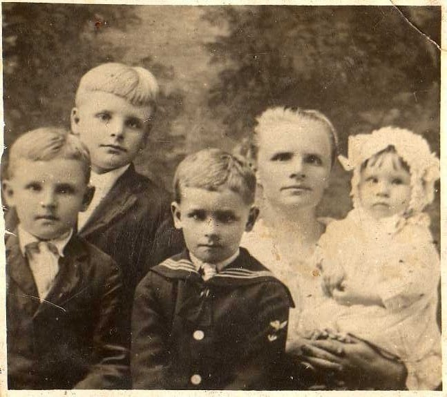 A woman and her four children in the 1900s