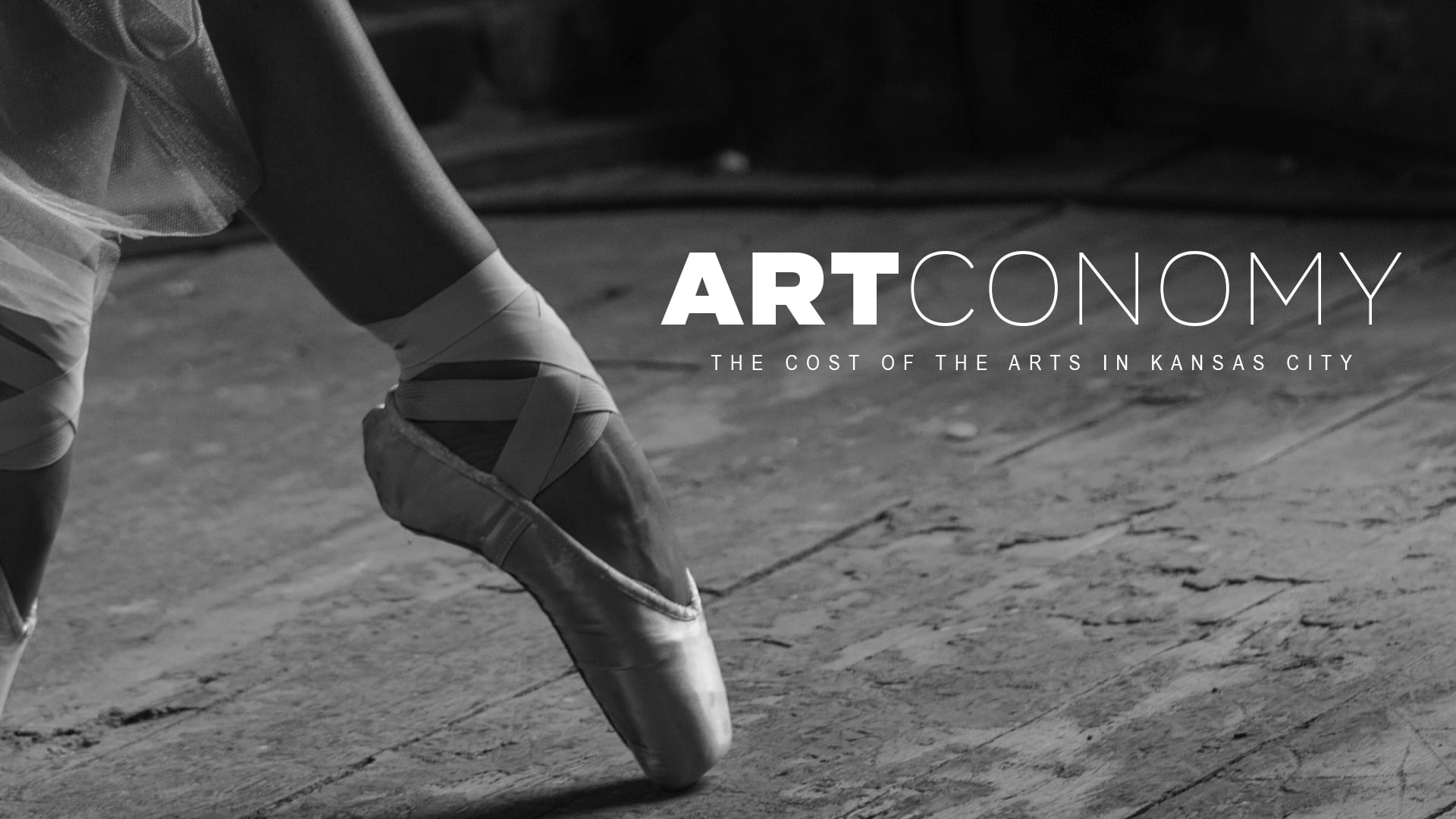 A ballerina's foot and the words Artconomy