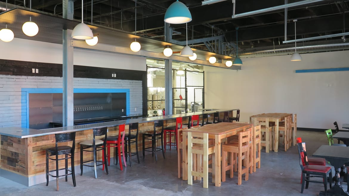 The taproom and brewhouse at Strange Days Brewing