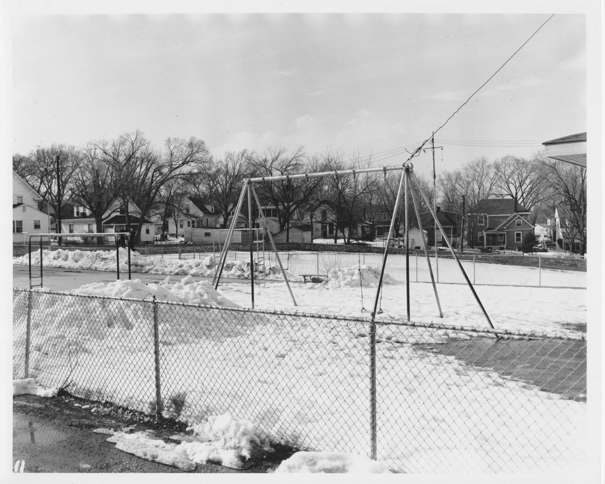 A fence separated the playground outside the Kansas City Orphan Boys' Home from Westport Road.