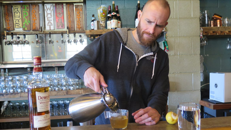 Bartender Sam Shepard serves a hot worty