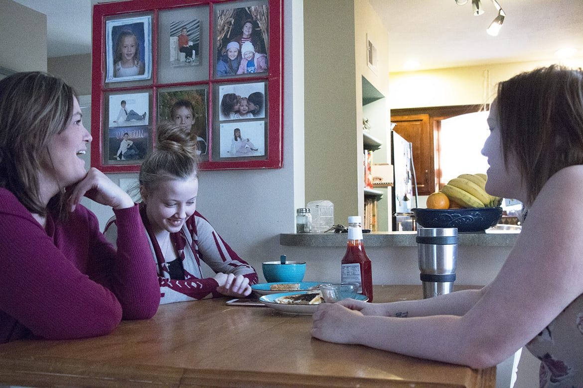Dawn Myers and her daughters at their dining room table
