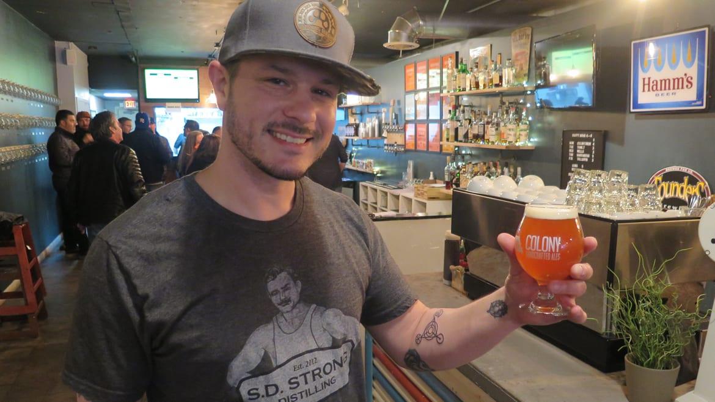 Colony KC brewer Rodney Beagle hefts a glass of Island Pie coconut cream pie ale
