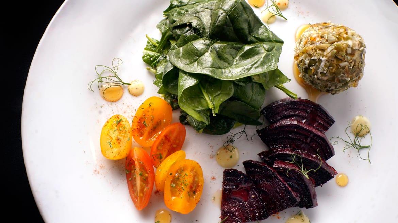 A deconstructed arugula-beet salad
