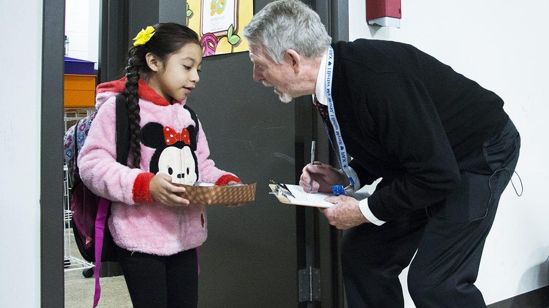 paul preston greeting a student