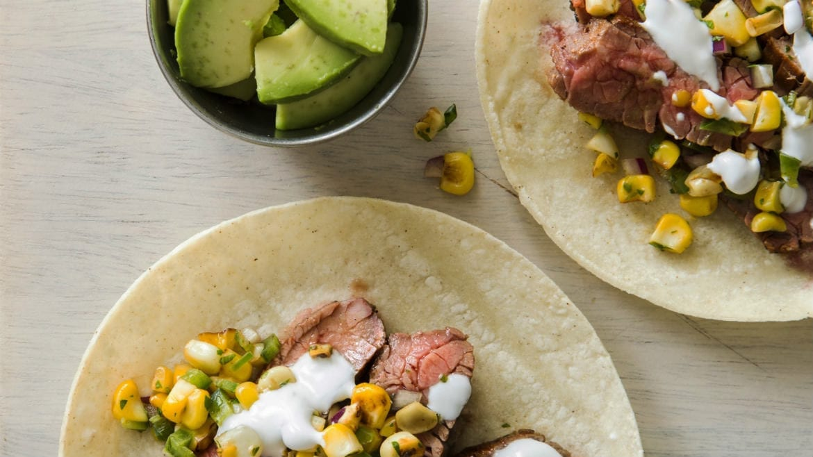 Flank steak tacos with charred corn salsa.