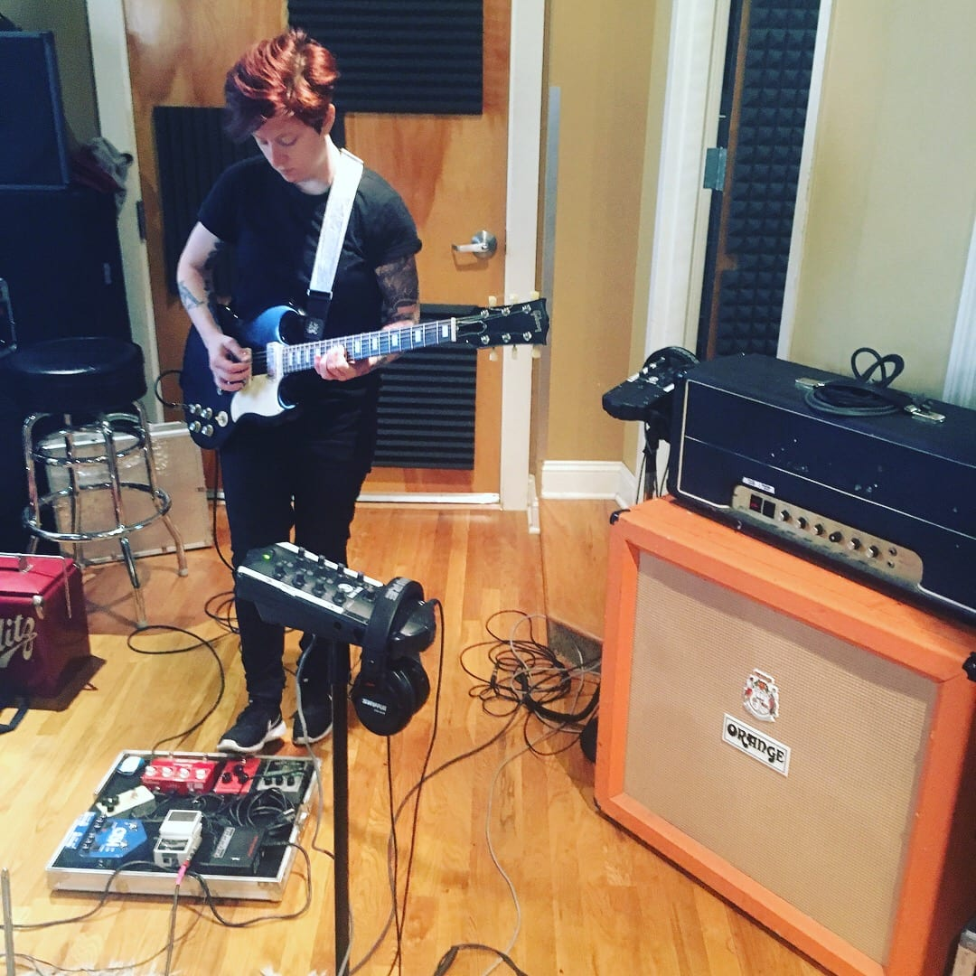 band member recording a track