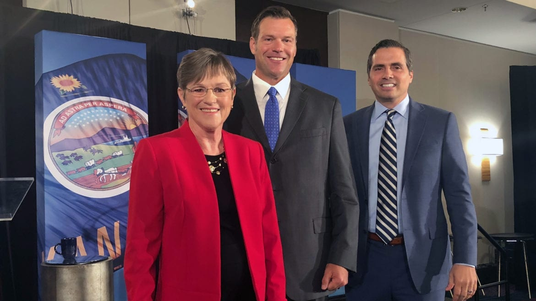 Laura Kelly Ileft), Kris Kobach (center), and Greg Orman